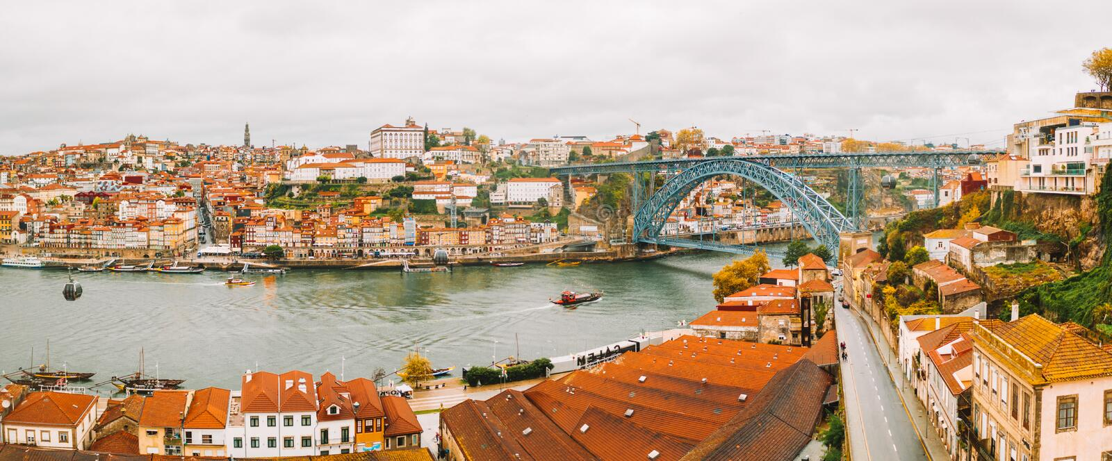 Panoramic aerial view of old houses of Porto, Portugal with Luis I Bridge - a metal arch bridge. Over Douro River. It is a symbol of the city and a most popular royalty free stock photos