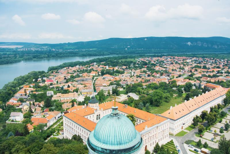Panoramic aerial view over the roofs of Esztergom town near Budapest, Danube river and a tower of Esztergom Cathedral at the fore royalty free stock photos