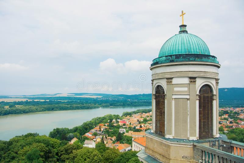 Panoramic aerial view over the roofs of Esztergom town near Budapest, Danube river and a tower of Esztergom Cathedral at the fore. Ground royalty free stock photography