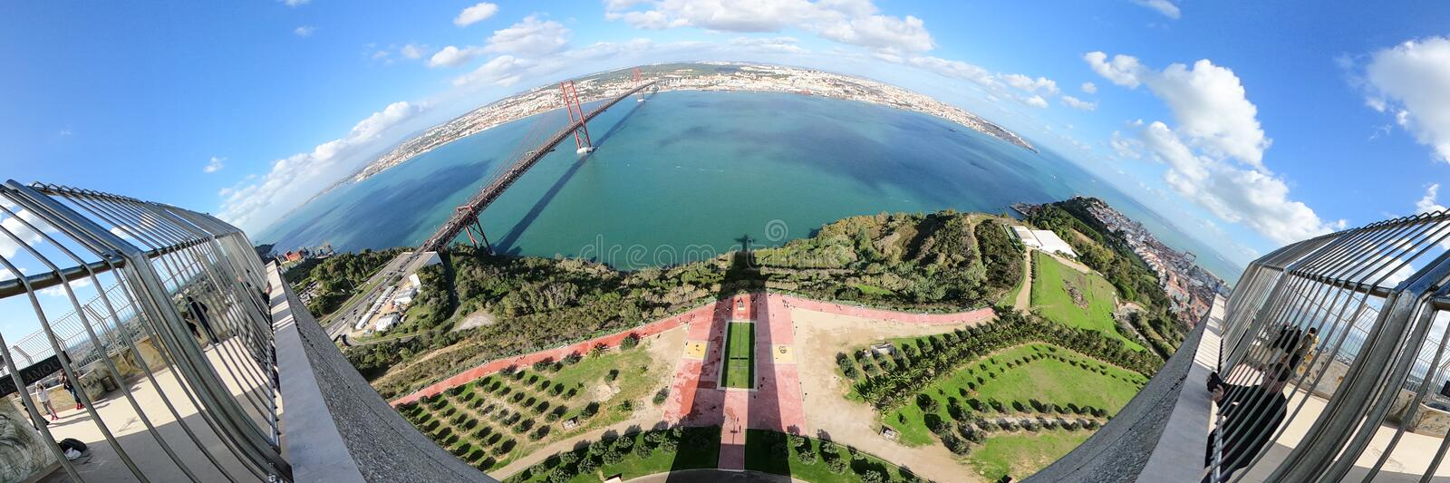 Panoramic aerial view over Shadow of Christ statue in Lisbon Almada royalty free stock photography