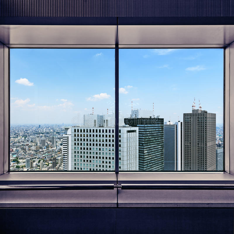 Aerial view of Shinjuku skyscrapers through a window frame. Tokyo, Japan. stock photo