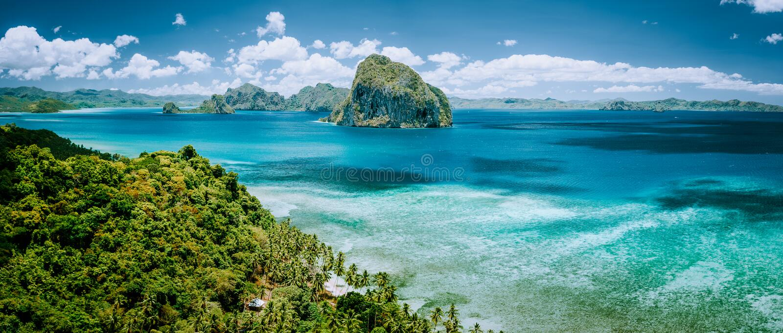Panoramic aerial view of tropical Palawan island with unique Pinagbuyutan island on horizon. El Nido-Philippines. Southeast Asia Bacuit archipelago stock photography