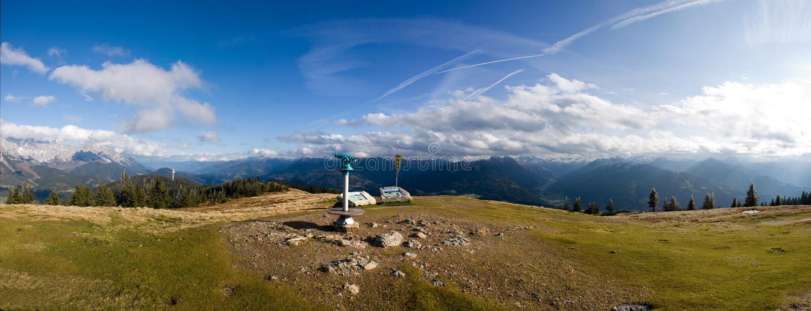 Panoramic Austrian mountaintop. A panoramic view from the top of an Alpine mountain near Flachau, Austria royalty free stock images