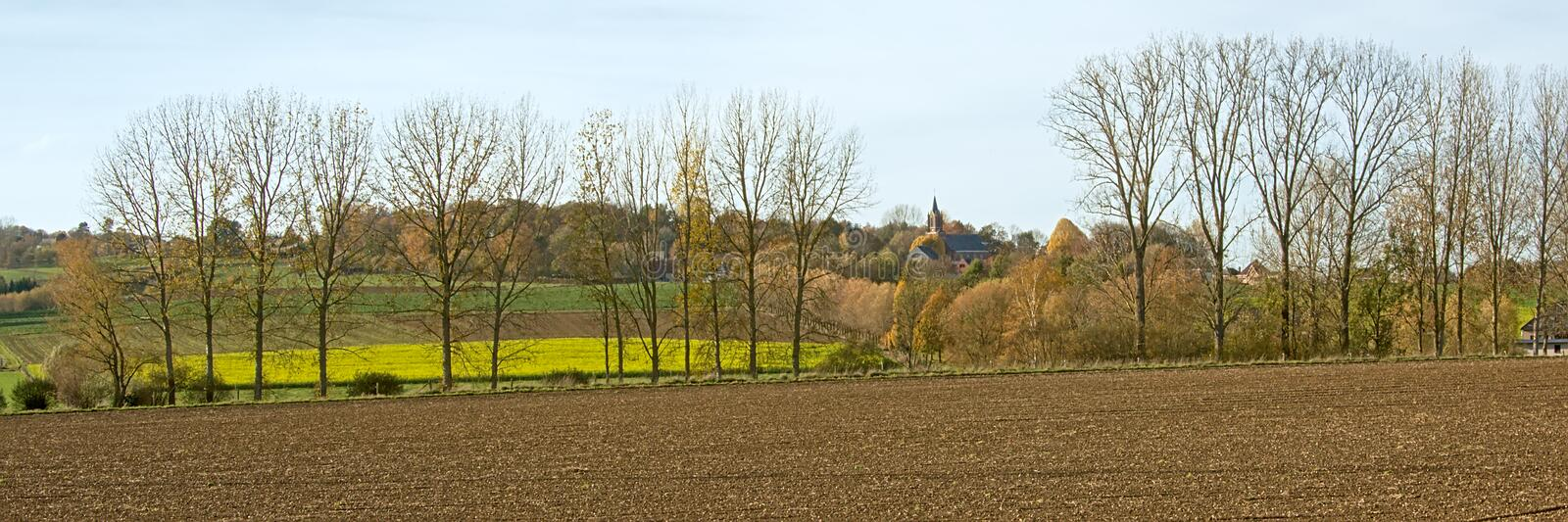 Panoramic autum pastoral landscape with church tower in the Flemish Ardennes, Belgium stock photo