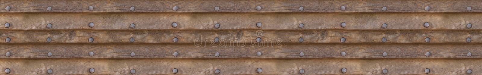 Panoramic background of wooden horizontal panels with metal rivets on isolated background. Panoramic background of wooden horizontal panels with metal rivets on stock photos