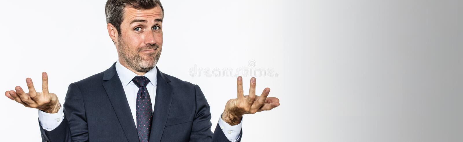 Panoramic banner for happy businessman showing his carefree or irresponsibility. Happy handsome bearded businessman showing his hands up for carefree success or stock photos