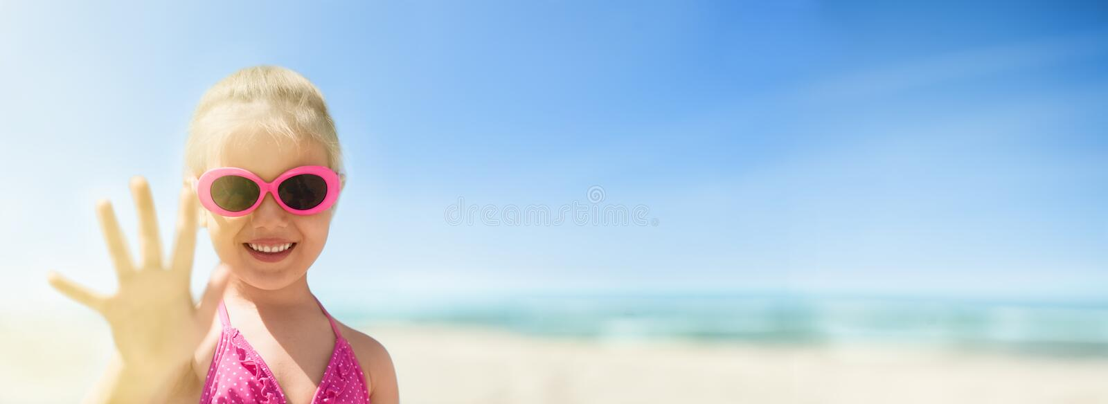 Panoramic beach view of the sea and happy kid waving hand stock images