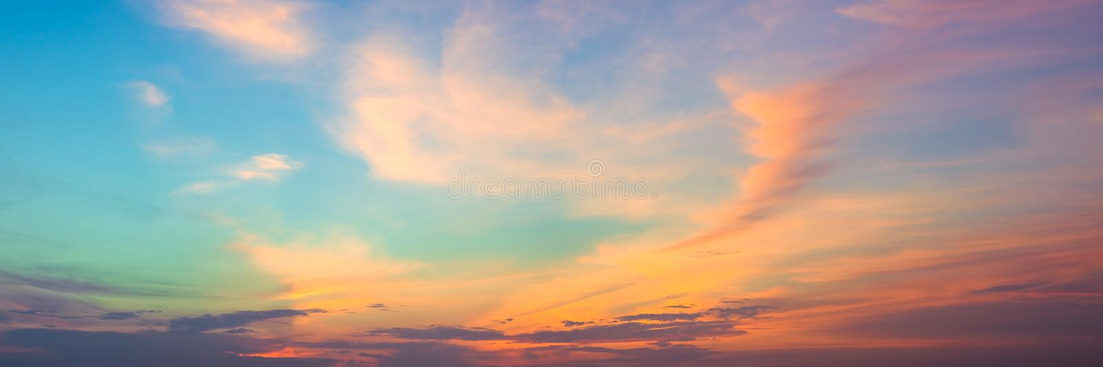 Panoramic beautiful colorful golden hour twilight sky. Beautiful cloud and sky nature background in magic hour. Amazing colorful royalty free stock image