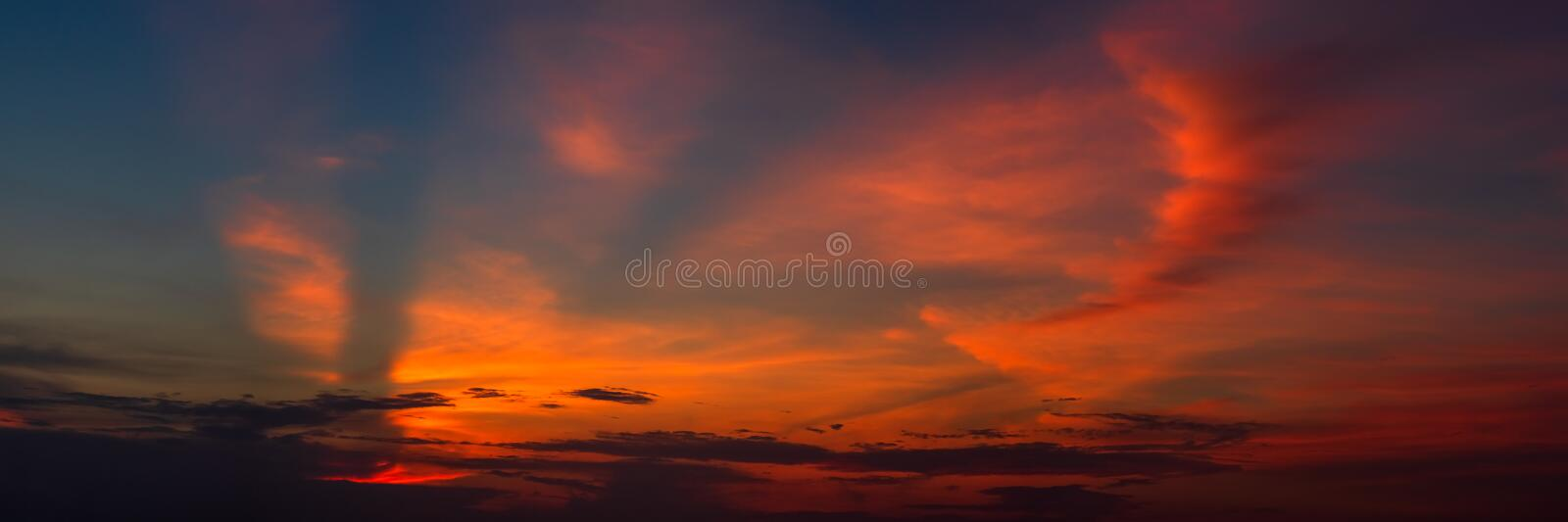 Panoramic beautiful colorful golden hour twilight sky. Beautiful cloud and sky nature background in magic hour. Amazing colorful stock photos