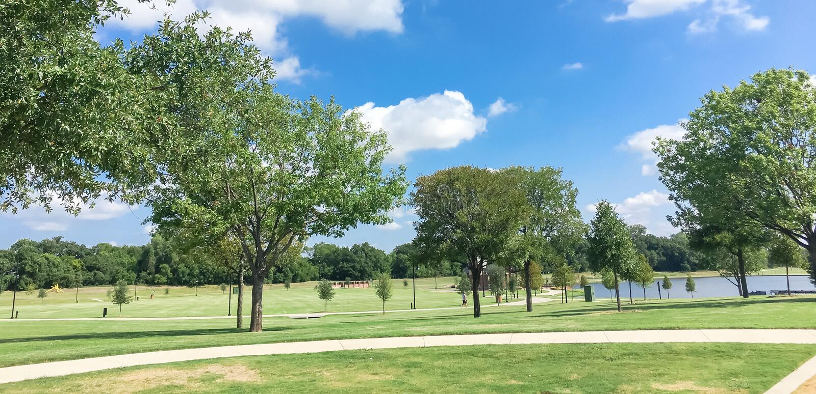 Panoramic beautiful green park with pathway trail in Coppell, Te stock photos