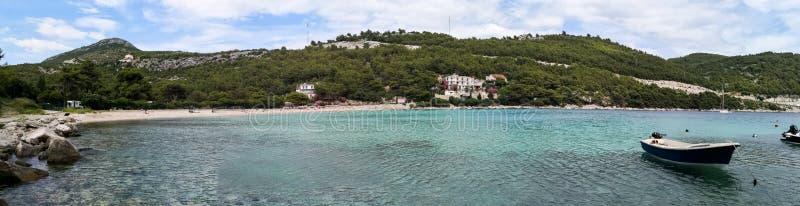 A peaceful beach in croatia. A panoramic beautiful view of a beach on the adriatic coastline of croatia mediterranean resort sea dalmatia bay tourism blue travel stock photos