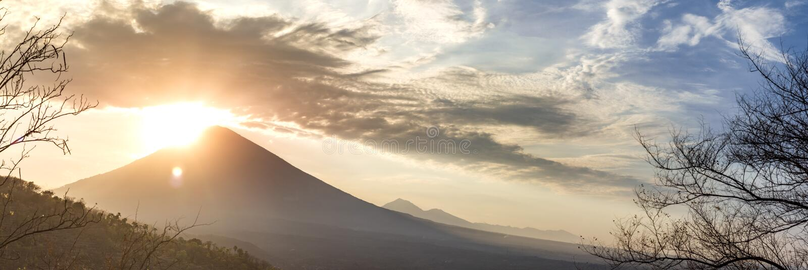 Panoramic beautiful view view of the mountains at sunset. evening cloudy view of the volcano ?gung, Bali stock photography