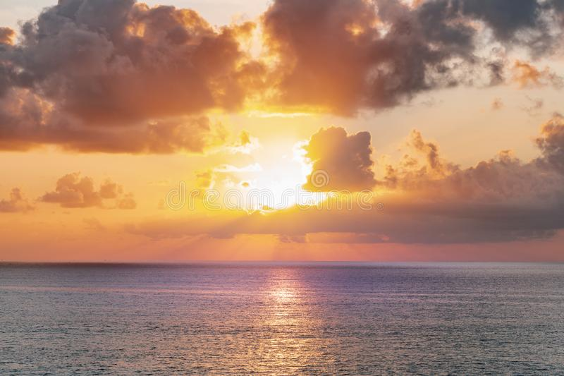 Panoramic beautiful view on sunset over the ocean. ?olorful cloudy sky and setting sun royalty free stock photo