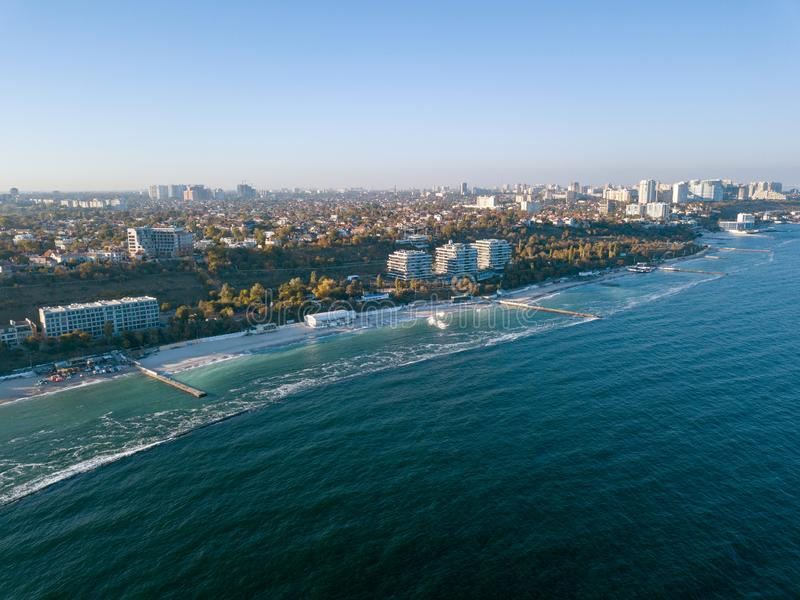 Panoramic bird`s eye arial view from drone the coastline of a developed city Odesa, Ukraine. Copy space. Picturesque seascape with coastline of city Odesa stock image