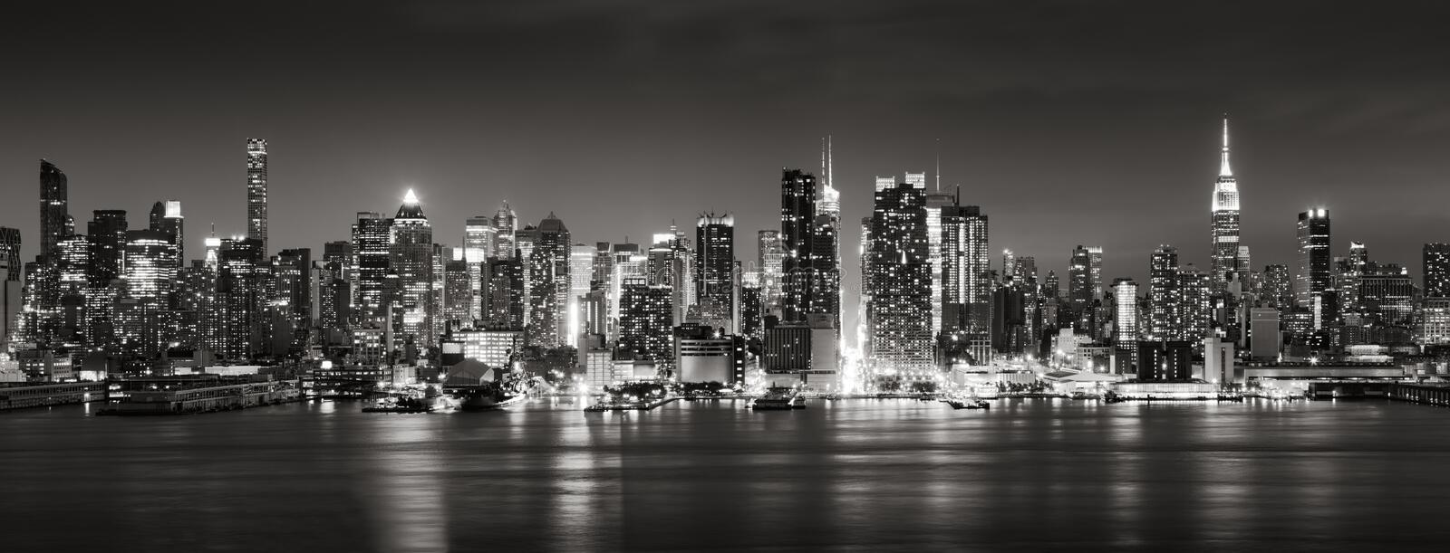 Panoramic Black & White view of Midtown West skyscrapers at night. Manhattan, New York City. Panoramic Black & White view of Midtown West skyscrapers with the royalty free stock photo