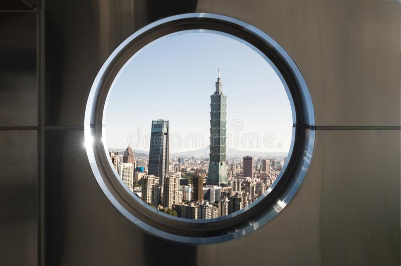 Circle windows with modern buildings in the city stock image