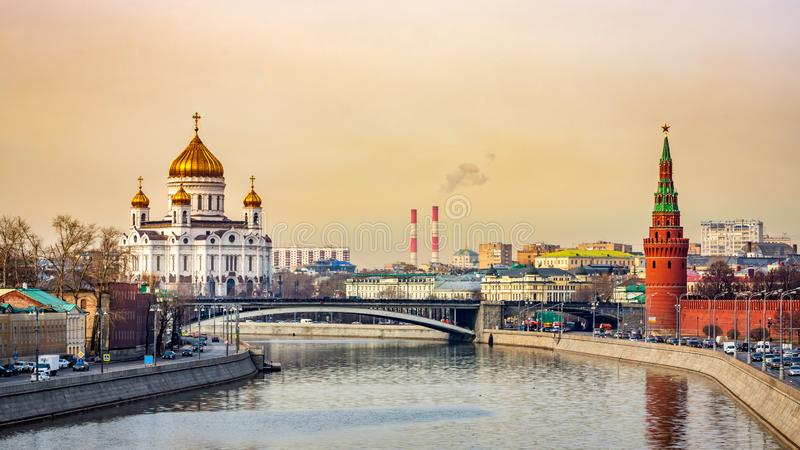 Cityscape with beautiful Cathedral of Christ the Saviour and Kremlin Vodovzvodnaya Tower, Moscow royalty free stock photography