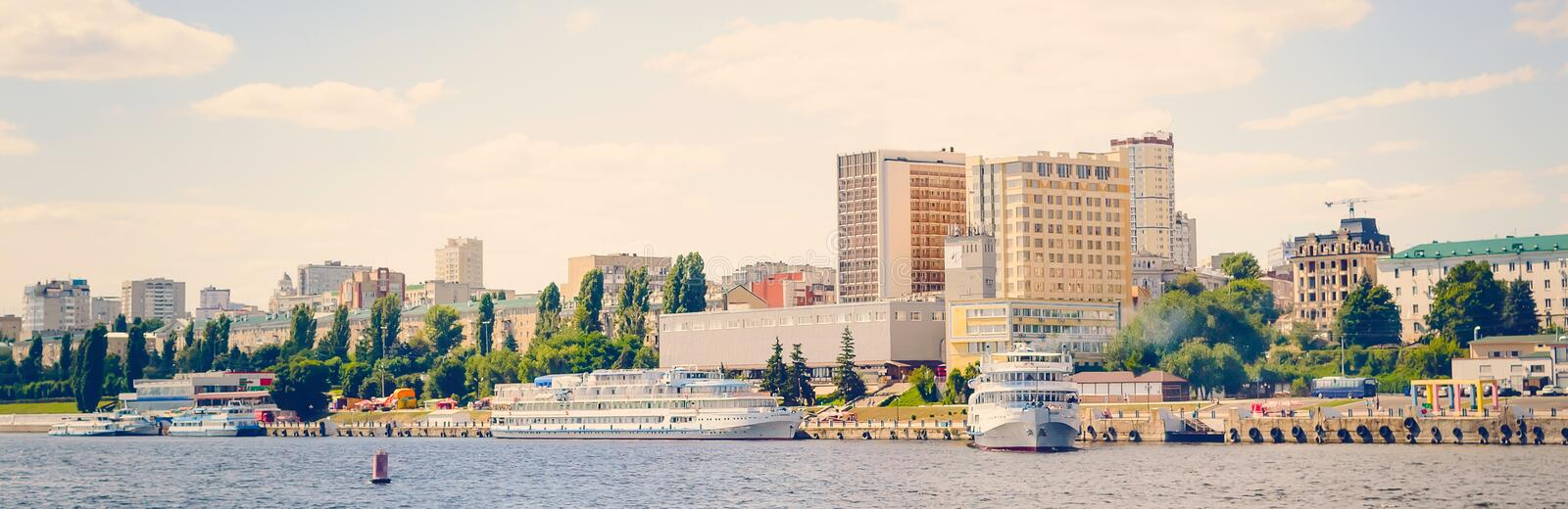 Panoramic cityscape and ships, view from the river side. Toning in the style of instagram stock photo