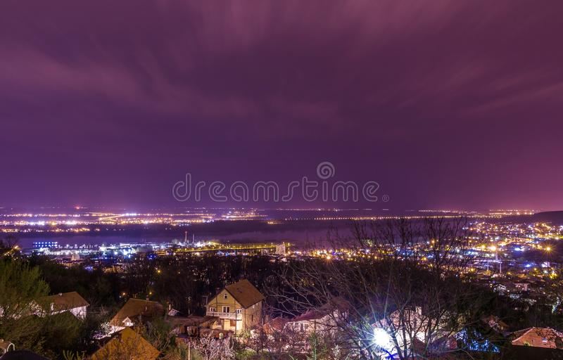 Panoramic cityscape view on Danube river in Belgrade with beautiful magenta sky and moving clouds royalty free stock photo