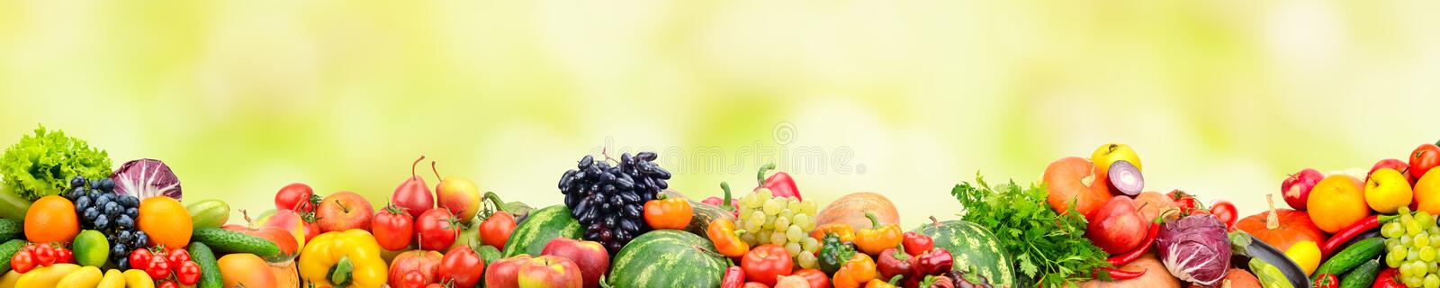 Panoramic collection fresh fruits and vegetables on yellow background. stock illustration