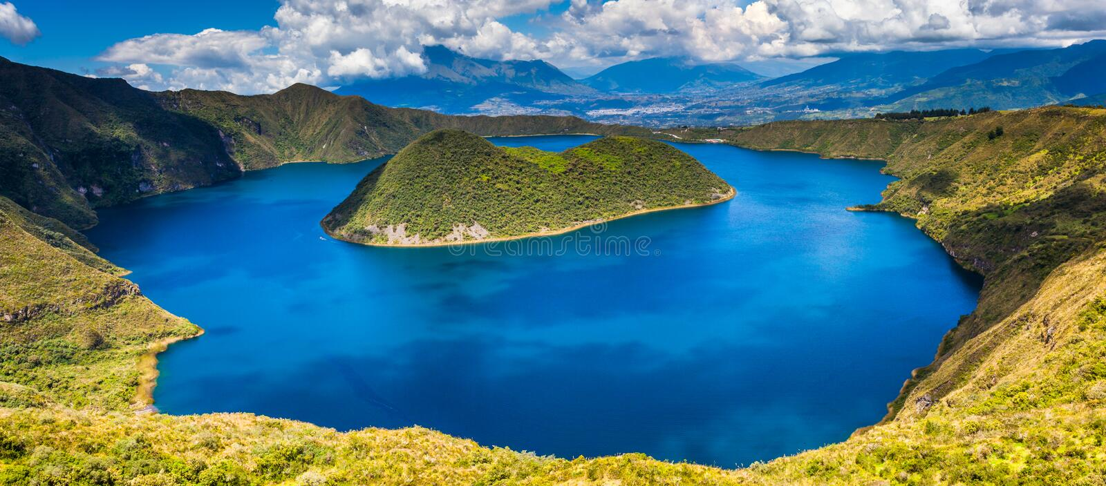 Cuicocha lagoon inside the crater of the volcano Cotacachi. Panoramic of Cuicocha, beautiful blue lagoon inside the crater of Cotacachi volcano stock images