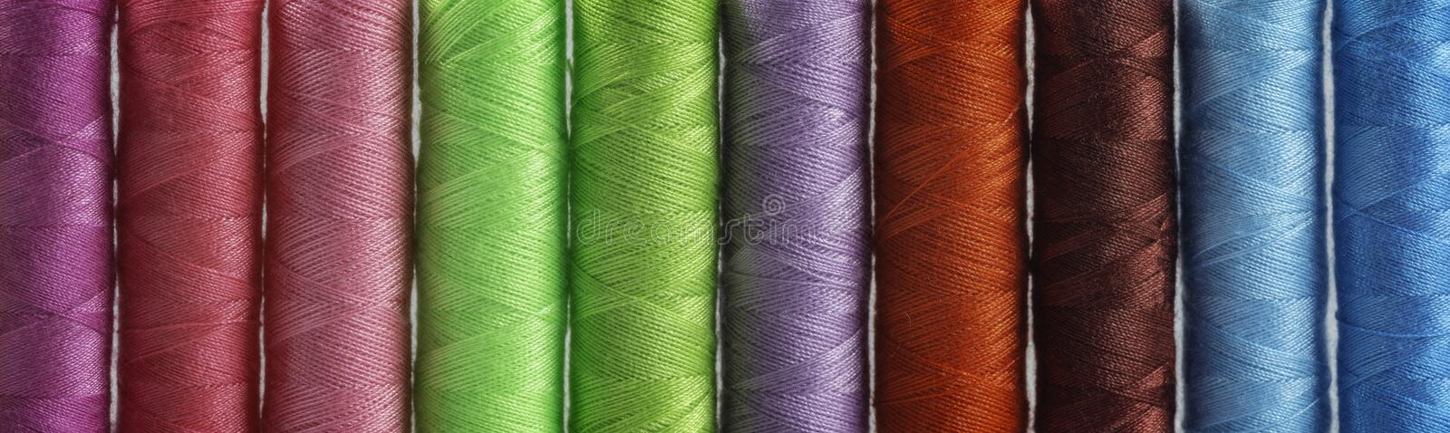 Detail view of differently colored spools of thread royalty free stock photography