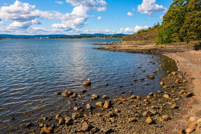 Panoramic view of rocky seashore of Hovedoya island in Oslofjord harbor near Oslo, Norway. Panoramic early autumn view of rocky seashore of Hovedoya island in royalty free stock photography