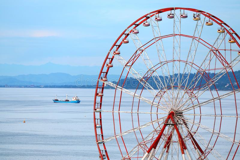 The Panoramic Ferris Wheel of Batumi against Georgia`s Black Sea and Blue Sky, Georgia. Holiday vacation royalty free stock image