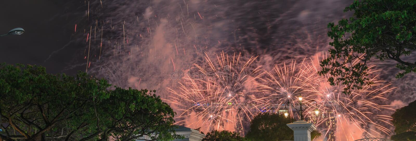 Panoramic firework display celebrating New Year party in downtown Singapore royalty free stock photos