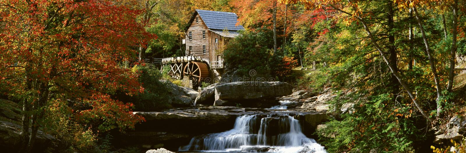 Panoramic of Glade Creek Grist Mil and autumn reflections and waterfall in Babcock State Park, WV stock photos