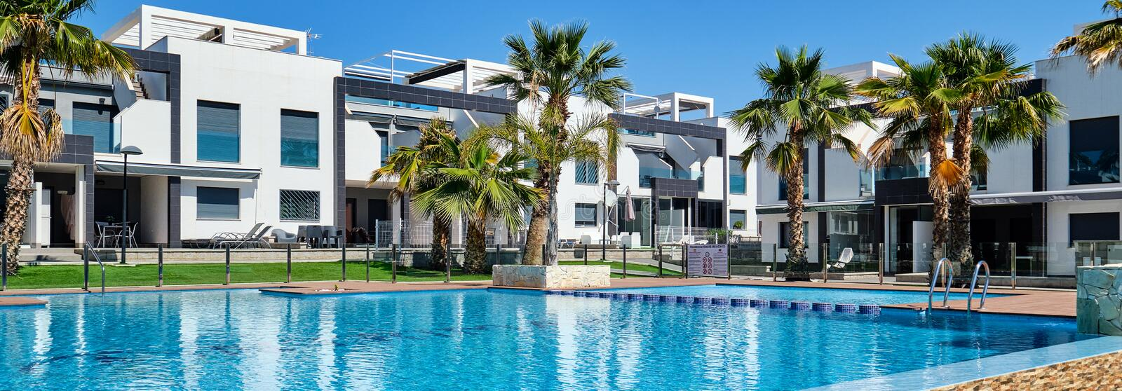 Panoramic image beautiful town houses with swimming pool, Torrevieja, Spain. Panoramic image beautiful contemporary modern town houses with swimming pool stock image