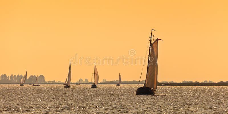 Panoramic image of Frisian Dutch sailing ships stock image