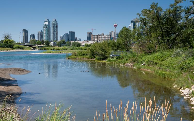 Calgary, Alberta, Canada. Panoramic image of the skyline of Calgary with the Bow River in the foreground, Alberta, Canada stock photos