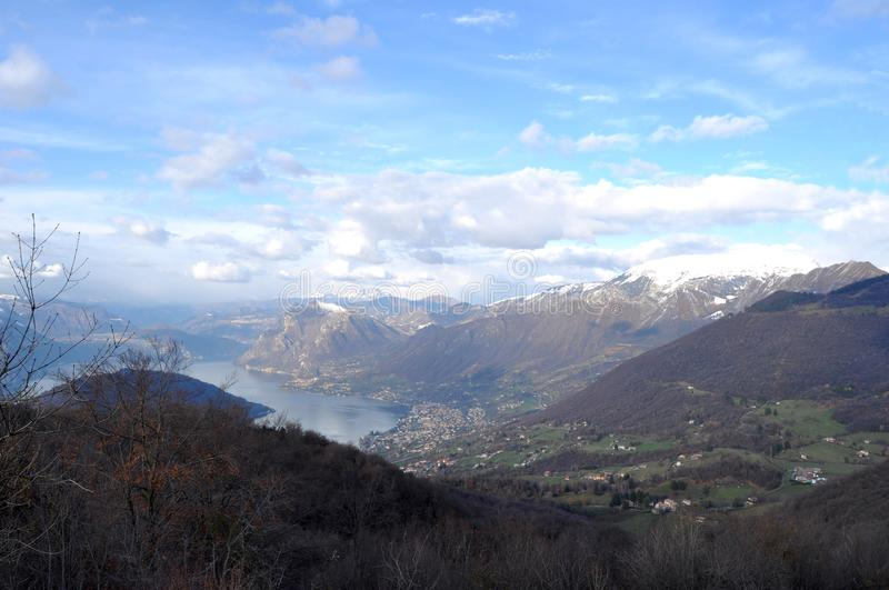 Panoramic image of Valcamonica with Lake Iseo and in the background the snow-capped mountains - Brescia - Italy 01 stock photography