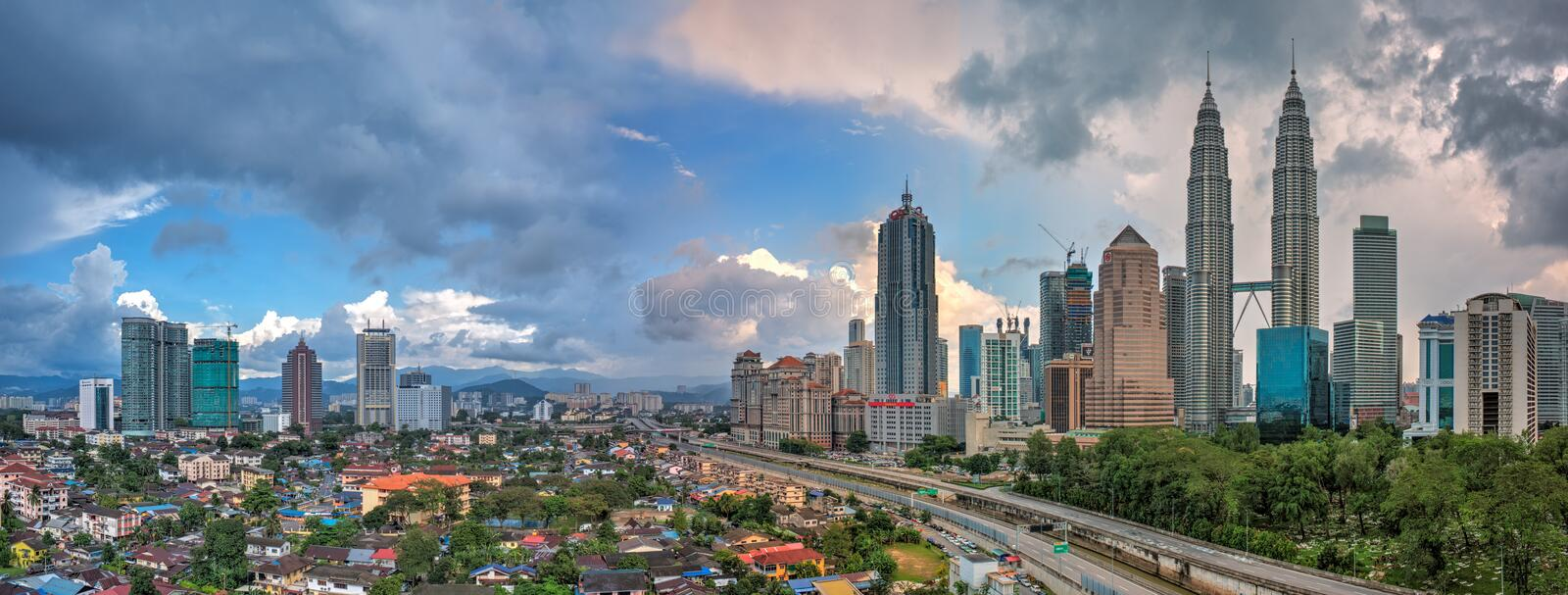 Panoramic of Kuala Lumpur and Petronas Twin Towers during daylight royalty free stock photography