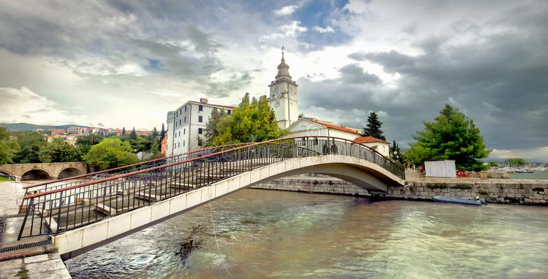 Bridge over canal and view of church tower in Crikvenica. Croatia stock photos