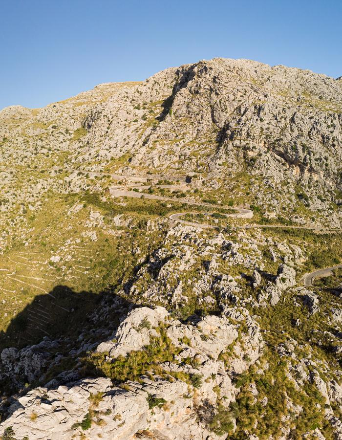 Panoramic landscape. Hairpin turn road between rocky mountains. Way to Sa Calobra beach, Mallorca, Balearic Islands. Panoramic landscape. Hairpin turn road MA royalty free stock photography