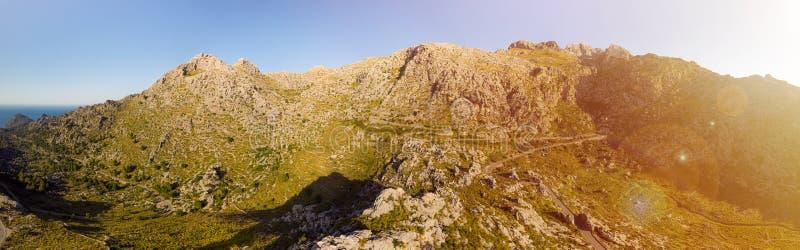Panoramic landscape. Hairpin turn road between rocky mountains. Way to Sa Calobra beach, Mallorca, Balearic Islands. Panoramic landscape. Hairpin turn road MA stock photos