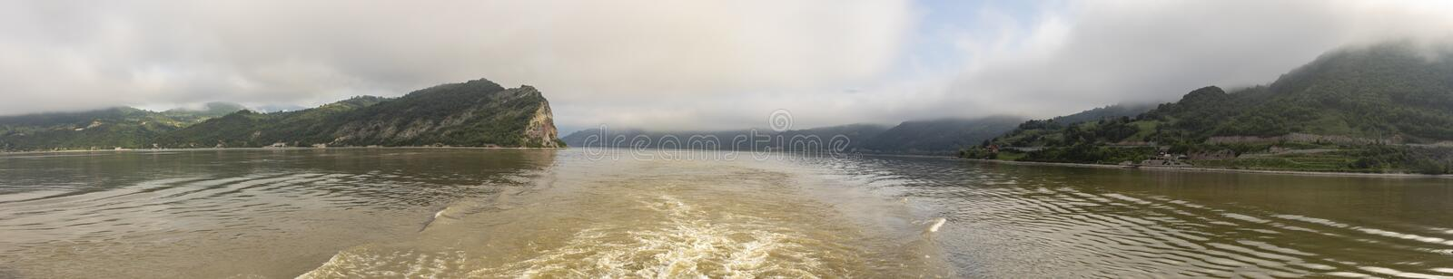 Panoramic landscape in Iron Gate gorge. Panorama of landscape shrouded in fog cruising through the Iron Gate gorges on the Danube River between Serbia and stock photography