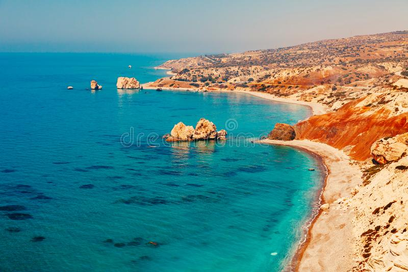 Panoramic landscape Petra tou Romiou (The rock of the Greek), Aphrodite's legendary birthplace in Paphos, Cyprus island,. Mediterranean Sea. Amazing blue green stock photography