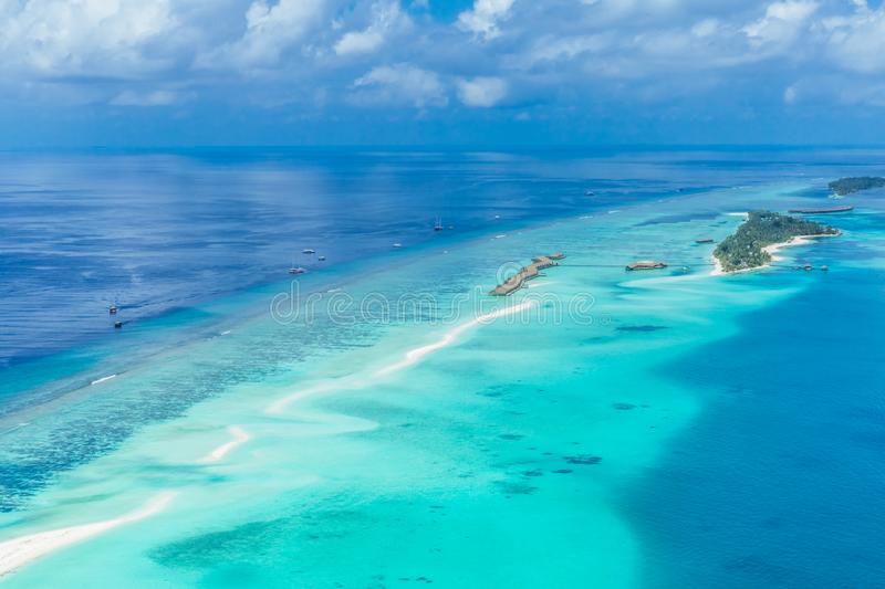 Panoramic landscape seascape aerial view over a Maldives Male Atoll islands. White sandy beach seen from above royalty free stock images