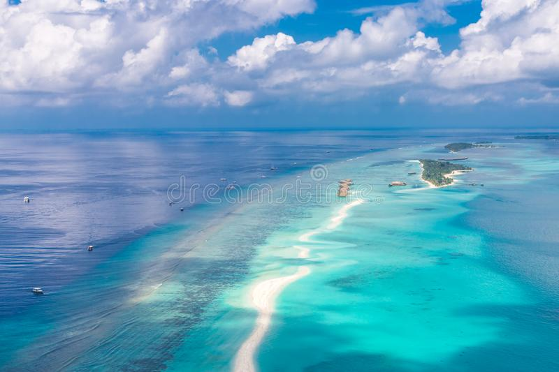 Panoramic landscape seascape aerial view over a Maldives Male Atoll islands. White sandy beach seen from above stock photos