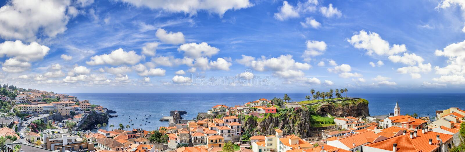 Panoramic landscape with view of Camara de Lobos, small fisherma. N village on Madeira island. Copy space stock photo
