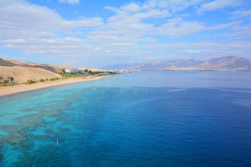 Mountain and coral reef in the Red sea, Israel, Eilat. Panoramic landscape view. Panoramic landscape view of mountains and coral reef in the Red sea, Israel royalty free stock photos