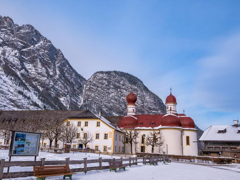 Panoramic landscape view of scenic mountain scenery with Church Saint Bartholomew winter snow season royalty free stock photography