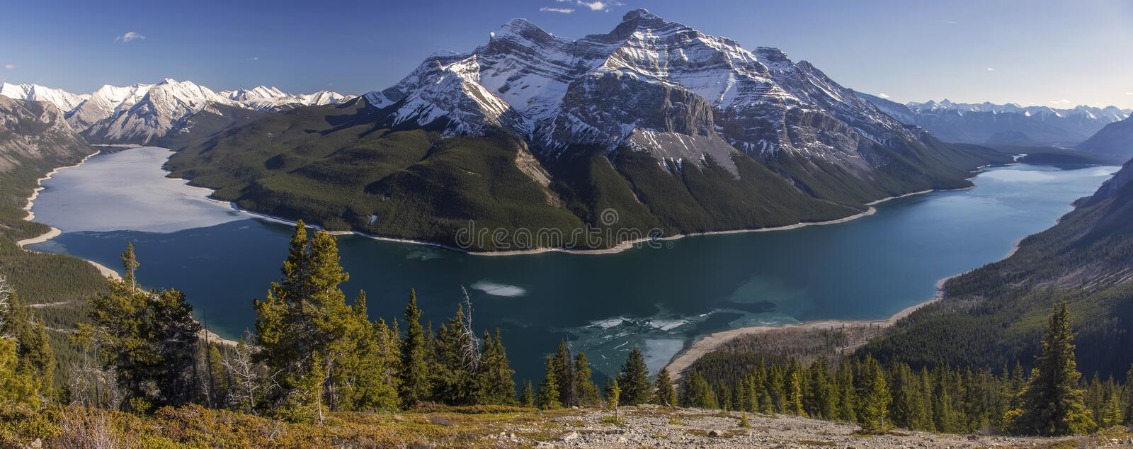 Lake Minnewanka Banff National Park Canadian Rocky Mountains. Panoramic Landscape view of Snowy Mountain tops above Lake Minnewanka from Aylmer Lookout in late royalty free stock images