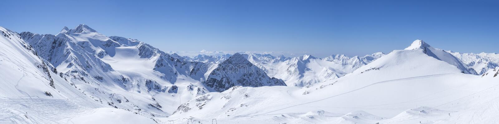 Panoramic landscape view from top of Schaufelspitze on winter landscape with snow covered mountain slopes and pistes at stock image