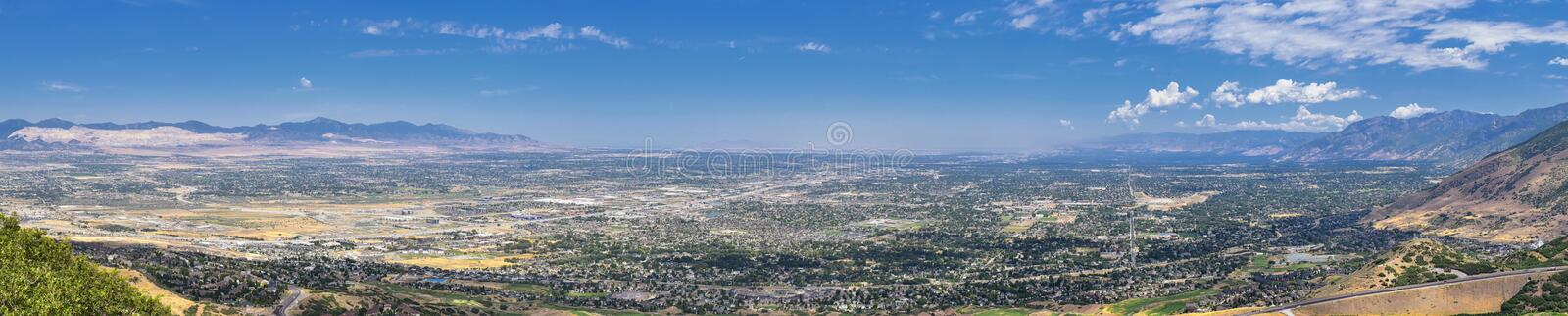 Panoramic Landscape view of Wasatch Front Rocky and Oquirrh Mountains, Rio Tinto Bingham Copper Mine, Great Salt Lake Valley in su stock image