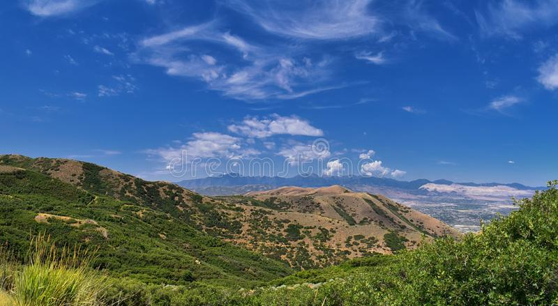 Panoramic Landscape view of Wasatch Front Rocky and Oquirrh Mountains, Rio Tinto Bingham Copper Mine, Great Salt Lake Valley in su. Mmer with Cloudscape. Utah royalty free stock images