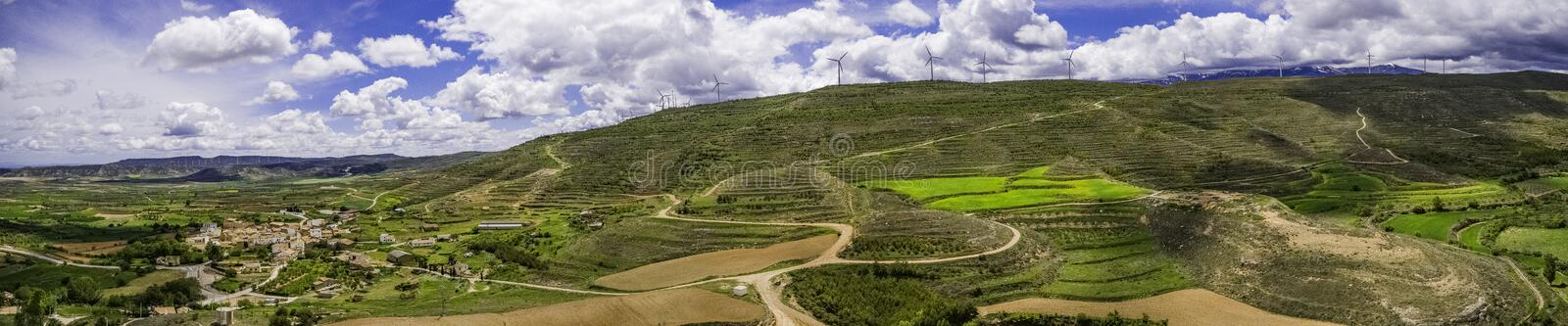 Panoramic landscape view with wind energy mills stock images